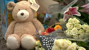 Flowers have been left outside the house in Harwich Road.