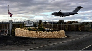 The plane landing at RAF Brize Norton