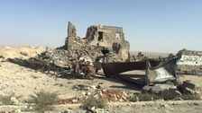 The road into western Aleppo is lined with destruction.