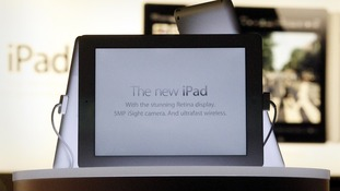 New iPad tablets are seen in a window display in an Apple store in Sydney