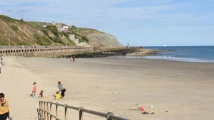 Three teenagers arrested over rape allegations on Kent beach