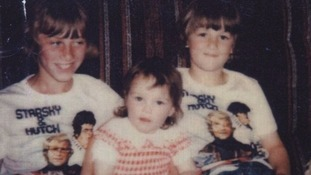 John Greenwood, 11, with sister Deborah, two, and brother David, eight