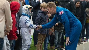 British astronaut Tim Peake meets a child at the event