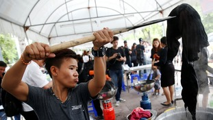 Dyeing stations pop up across Bangkok as black clothes become too expensive after king's death