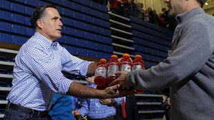 US Republican presidential nominee Romney accepts relief supplies for people affected by the storm in Kettering, Ohio