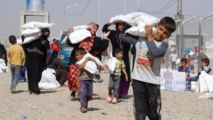 Civilians who fled Mosul and Hawija are pictured in a refugee camp earlier this month.