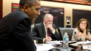 President Obama participates in a conference call with electric utility executives to discuss the restoration of power.