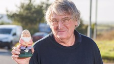 Bryan Gibson and Cormy the gnome who features in his photographs.