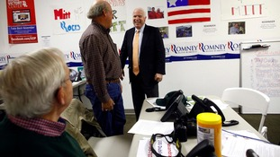 Senator John McCain meets volunteers at the campaign headquarters for Mitt Romney in Columbus, Ohio