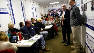 Senator John McCain and Senate candidate Josh Mandel speak to volunteers at campaign headquarters for Mitt Romney in Columbus, Ohio