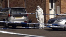 Forensic teams at the scene of the murder in 2014.
