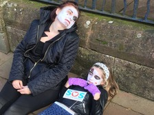 Protestors dressed as corpses outside a Success Regime meeting.