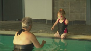 Six-year-old amputee makes waves in swimming lessons