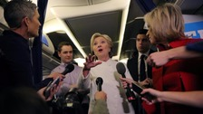 Hillary Clinton gives a briefing inside her campaign plane following the debate.