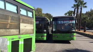 Buses are waiting to transport people