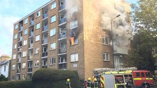 Woman escapes burning flat via third floor balcony