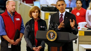 Barack Obama talks about damage done by Hurricane Sandy and rescue efforts at the National Red Cross Headquarters yesterday