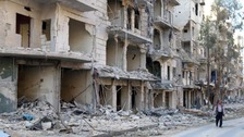 Damaged buildings in the rebel held besieged al-Sukkari neighbourhood of Aleppo.