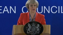Theresa May speaks after her first EU summit.