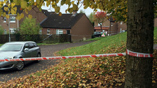 A police cordon at Glenwood Court in west Belfast