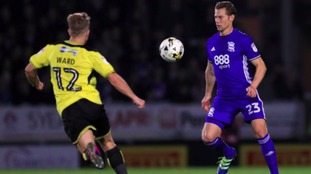 Birmingham City's Jonathan Spector (right) and Burton Albion's Jamie Ward battle for the ball