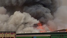 Firefighters battle large blaze at Seaforth Docks