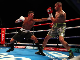 Ogogo (left) was retired by his corner in the eighth round