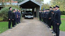 Fire fighters form a guard of honour