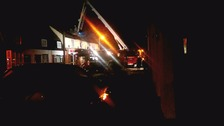 The first floor was completely alight when crews arrived.