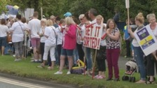 Teaching assistants have held a series of protests against the council's plans to change their contracts.