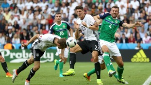 Germany's Thomas Muller heading a ball