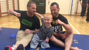 Meningitis quadruple amputee aged eight excels at mixed martial arts