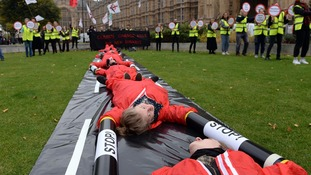 The protesters blocked a mock runway on College Green outside the Houses of Parliament.