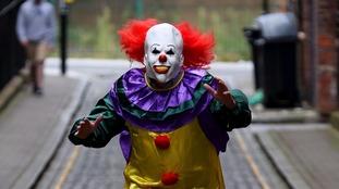 Hammer wielding 'killer clown' stabbed after scaring boy, 14
