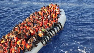 Refugees making the dangerous sea crossing in a rubber dinghy