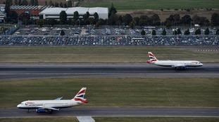 British Airways planes taking off and landing at Heathrow.