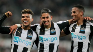 Newcastle United's DeAndre Yedlin and Newcastle United's Isaac Hayden celebrate with Newcastl's Aeyoze Perez after scoring the 6th goal