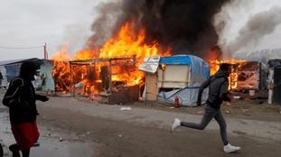 Calais 'Jungle' camp clearance 'over' as fires burn