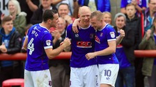 Carlisle United's Jason Kennedy (centre) celebrates with his team-mates Luke Joyce (left) and Nicky Adams