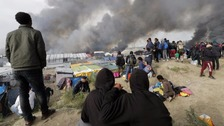 Calais 'Jungle' camp clearance 'over' as fires burn