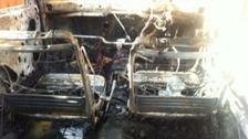 A car destroyed in an arson attack at Caia Park in Wrexham.