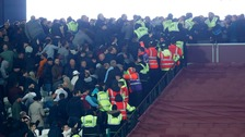 Fans clash in the stadium during West Ham v Chelsea