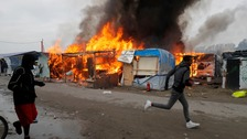 Children unaccounted for as Calais 'Jungle' camp burns