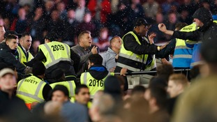 Fans clash in the stands.