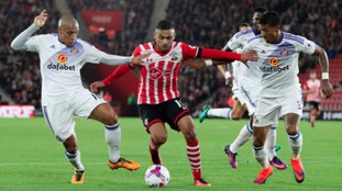 Southampton's Sofiane Boufal (centre) battles with Sunderland's Wahbi Khazri (left) and Patrick van Aanholt during the EFL Cup