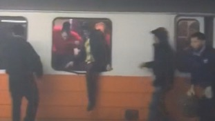 Passengers smashed open windows to flee smoke-filled train