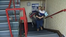 Family forced to carry disabled son up three flights of stairs to get home