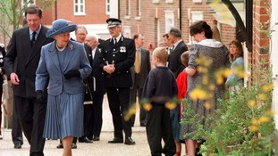 he Queen walks up Brookhouse Street at Poundbury, Dorset