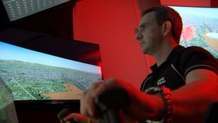 Pilot Simon Davies prepares himself in the flight simulator