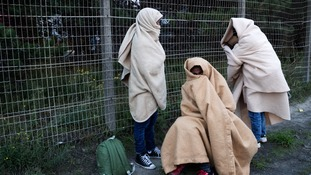 Three migrants with nowhere else to go.